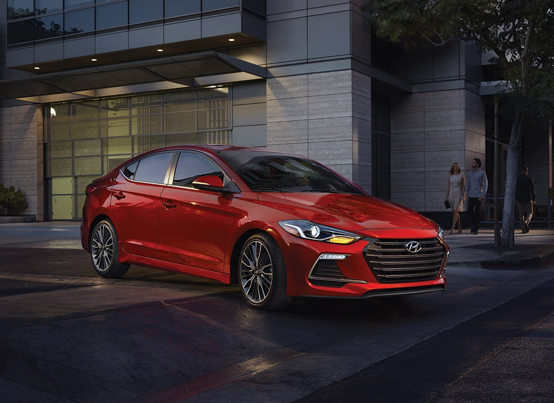 Image of a fiery red 2017 Hyundai Elantra on a dark city street