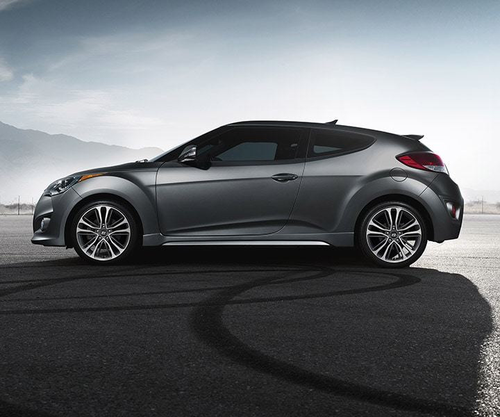 Exterior side shot of Hyundai Veloster Turbo 2016 with matte grey paint