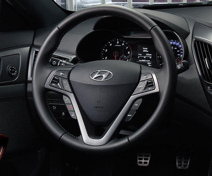 Image of Hyundai Veloster Turbo 2016 heated steering wheel with mounted audio controls and Bluetooth
