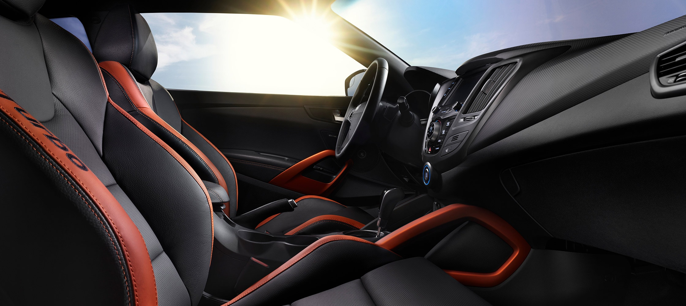 Interior image of Hyundai Veloster Turbo 2016 black leather interior with orange colour accents