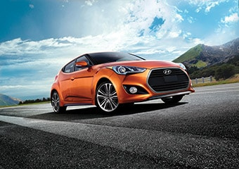 Exterior shot of orange Hyundai Veloster Turbo 2016 wide-mouthed turbo grill