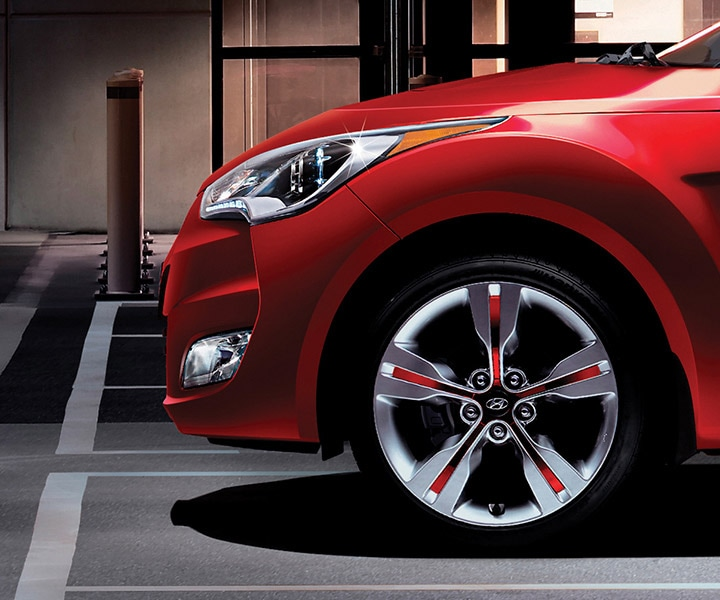 Exterior image of red Hyundai Veloster 2016 front 17 inch alloy wheel