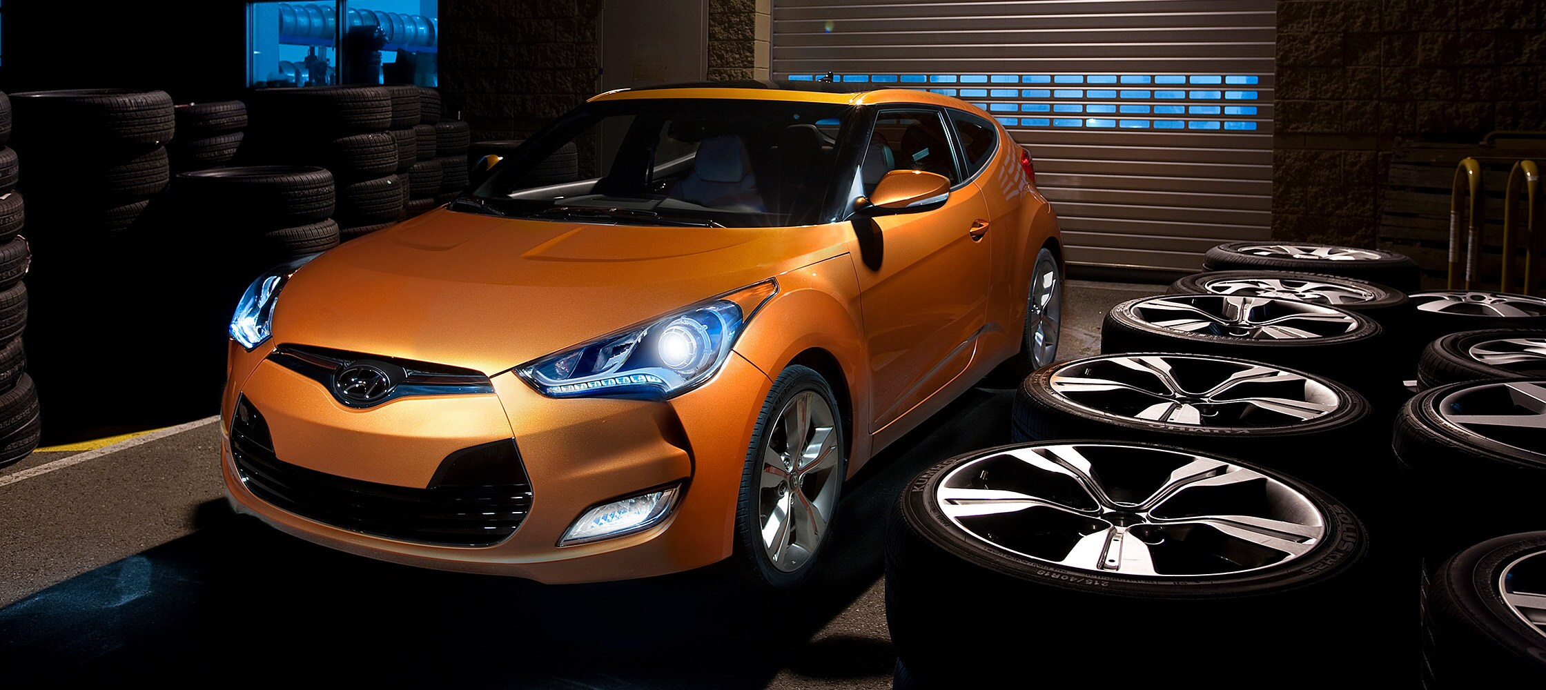 Exterior photo of orange Hyundai Veloster 2016 three door hatchback