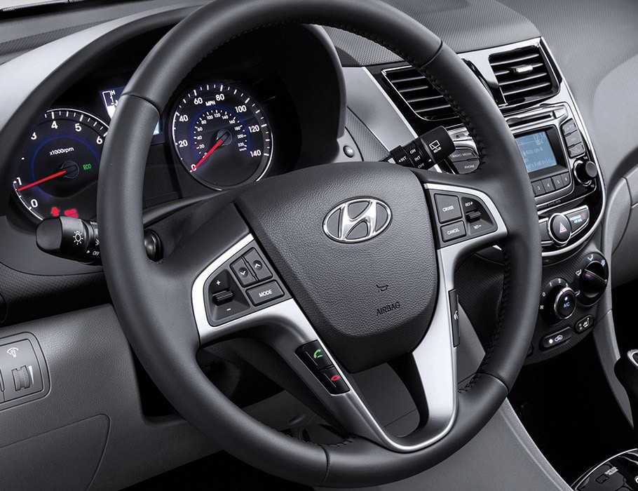 Interior photo of Hyundai Accent 2016 steering wheel-mounted controls for Bluetooth hands-free phone system