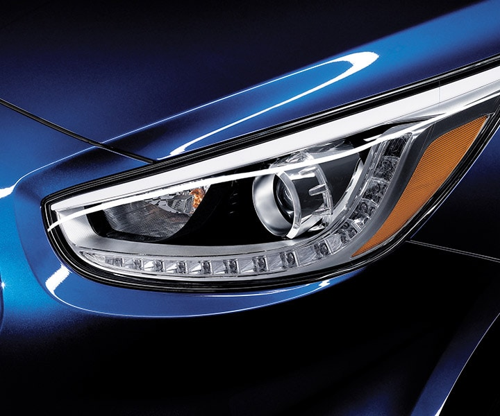 Blue Hyundai Accent Sedan 2017 close up view of projection headlights with LED daytime running lights