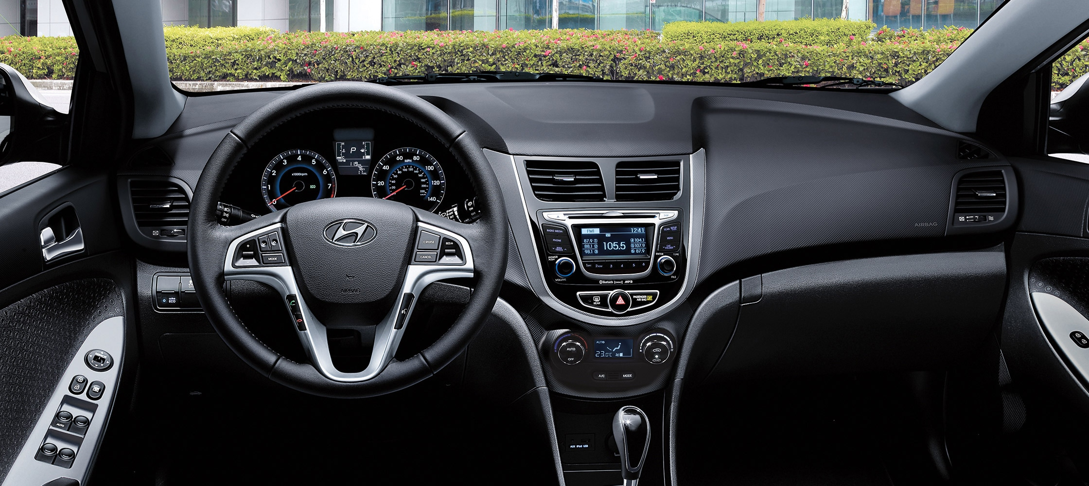 Hyundai Accent Sedan 2017  interior photo of driver's space with steering wheel and dashboard