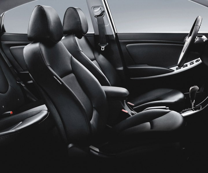 Side view photo of Hyundai Accent hatchback 2017 black heated seats