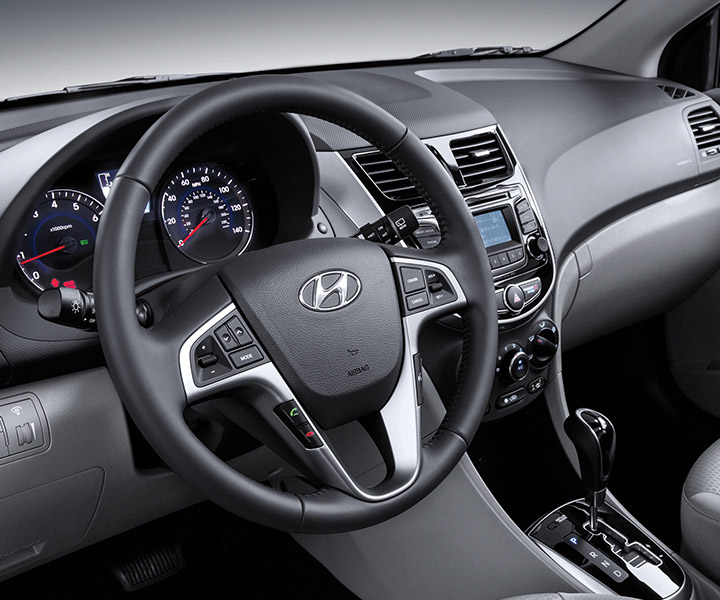 Interior photo of Hyundai Accent compact hatchback 2017 steering wheel-mounted controls to navigate personal playlists.