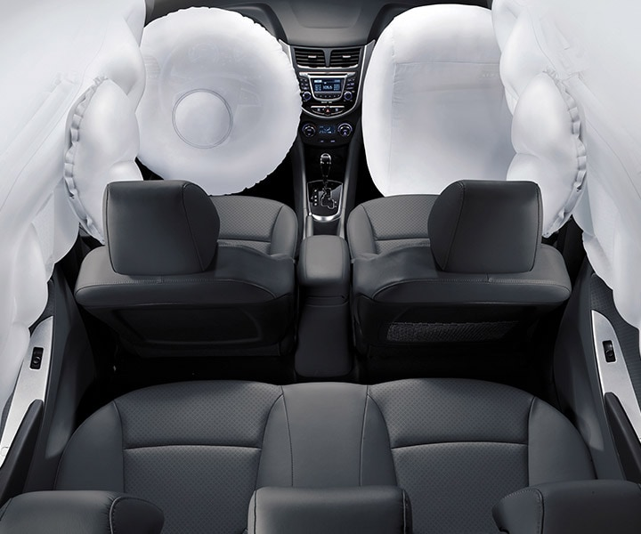 Interior photo of six deployed airbags in Hyundai Accent 2017; front, front side-impact and side-curtain airbags to ensure driver safety