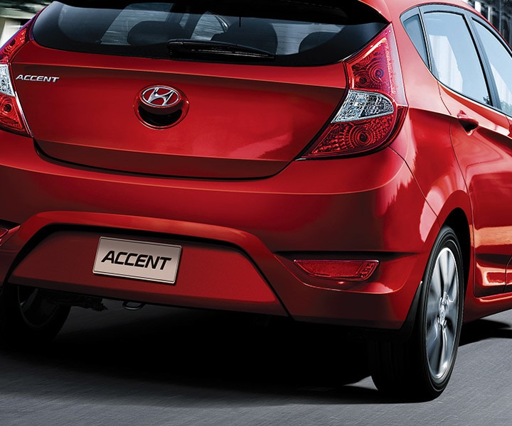 Exterior photo of Red Hyundai Accent compact five doors hatchback 2017