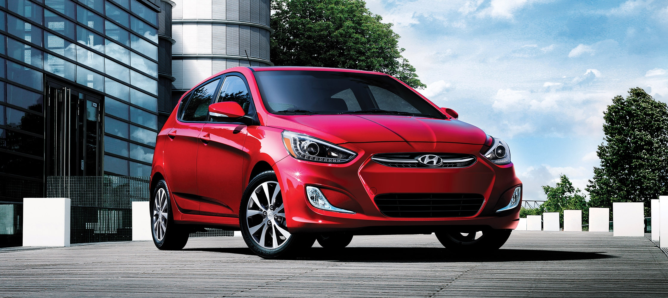 affordable hatchback car wheel steering hyundai interior looking img door space of driver s photo en accent with outwards new canada showroom