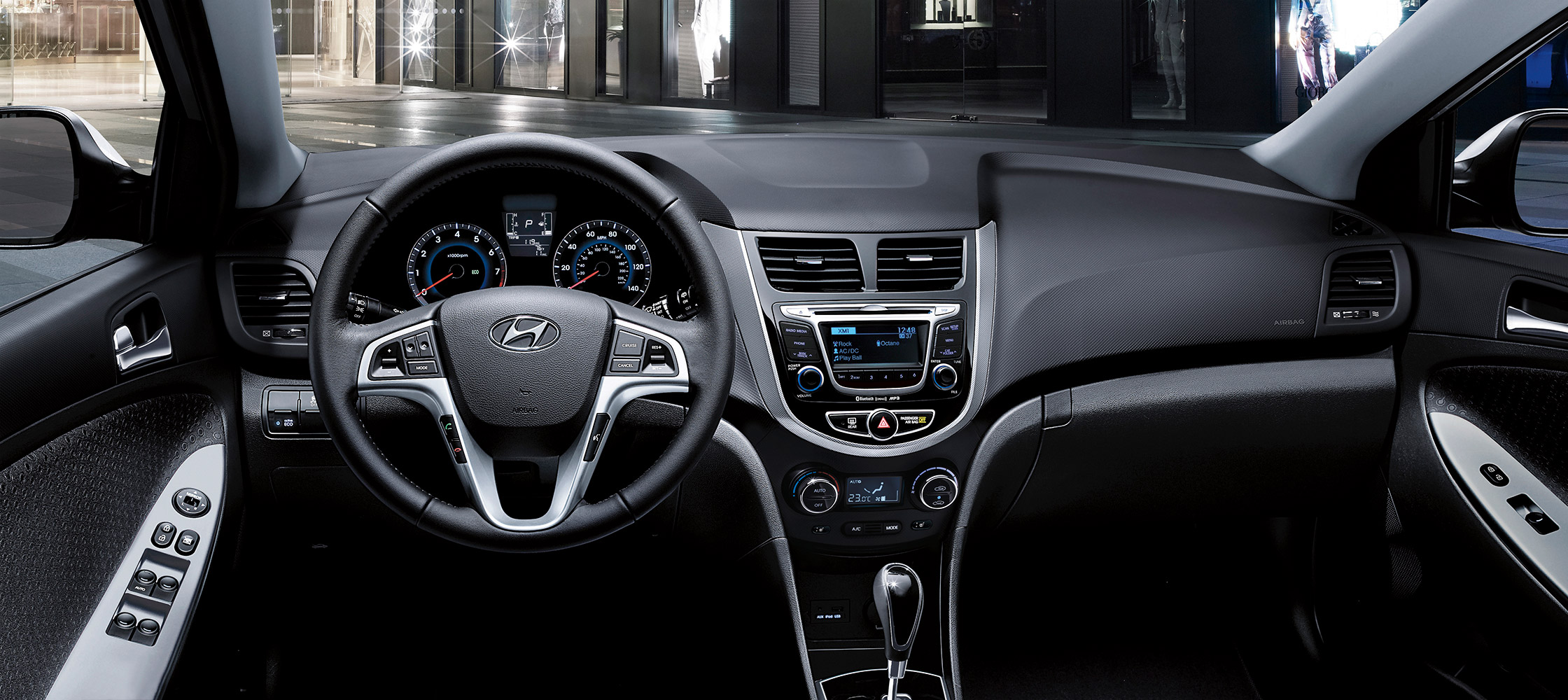 Hyundai Accent hatchback 2017  interior photo of driver's space looking outwards with steering wheel.