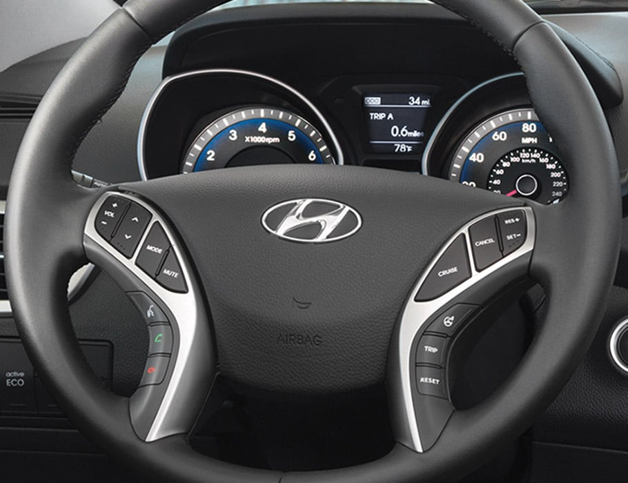 Image of Hyundai Elantra GT 2017 steering wheel with buttons and Hyundai logo