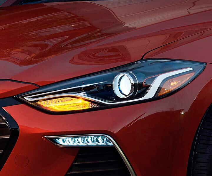 Close up view of red Hyundai Elantra Sport 2017 front HID headlight, improving visibility