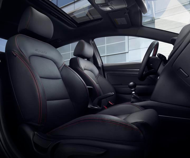 Interior view of Hyundai Elantra Sport 2017 power sunroof and black leather interior