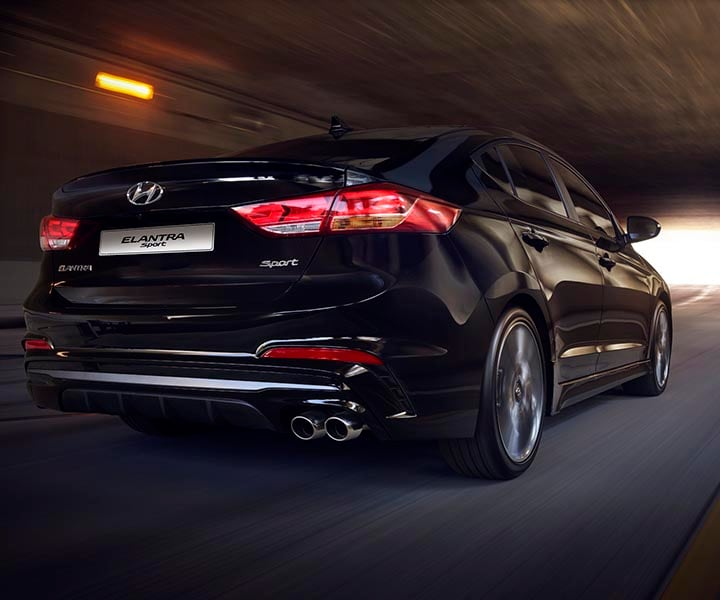 Rear photo of black Hyundai Elantra Sport 2017 with aggressive rear bumper and twin-tip exhaust