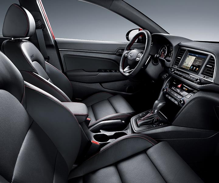 Interior view of Hyundai Elantra Sport 2017 heated black leather seats with red stitching interior