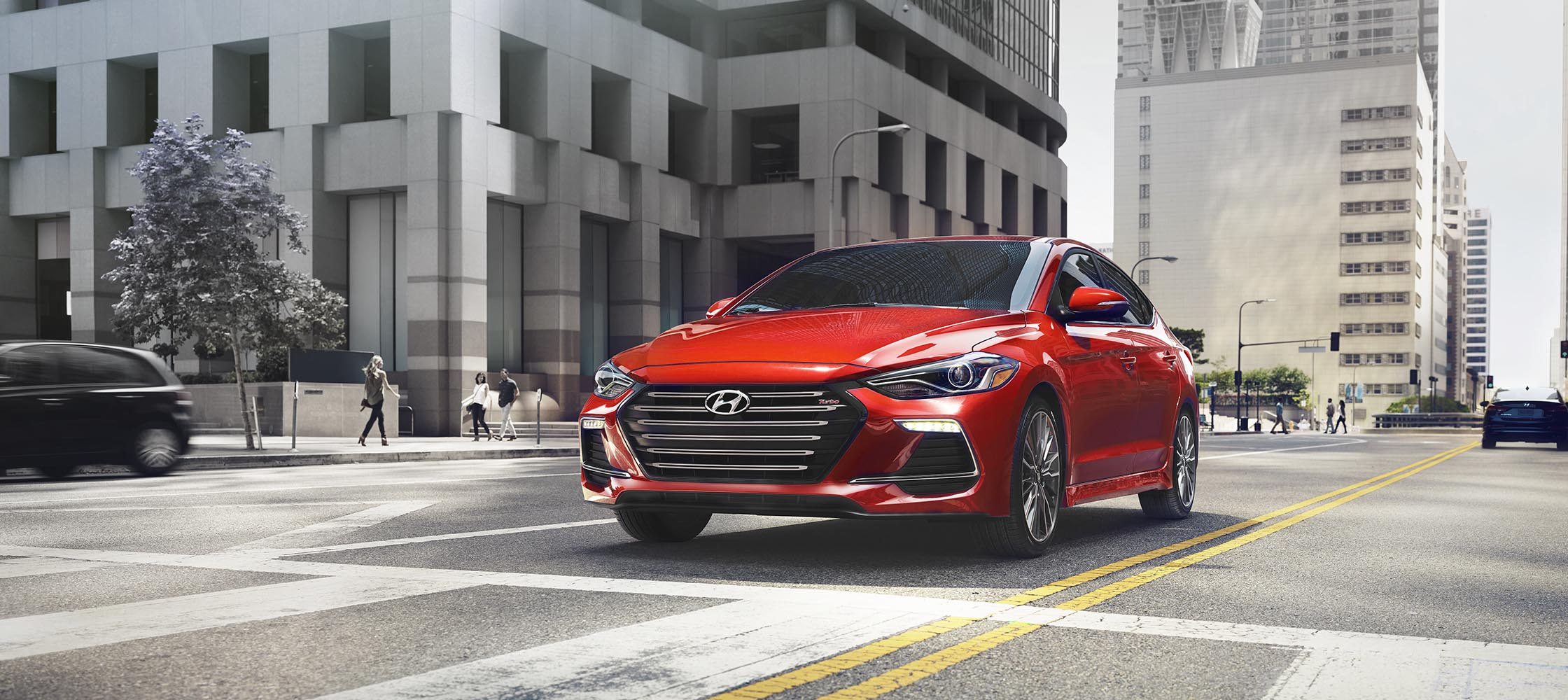 Exterior front image of Red Hyundai Elantra Sport 2017 driving on city streets