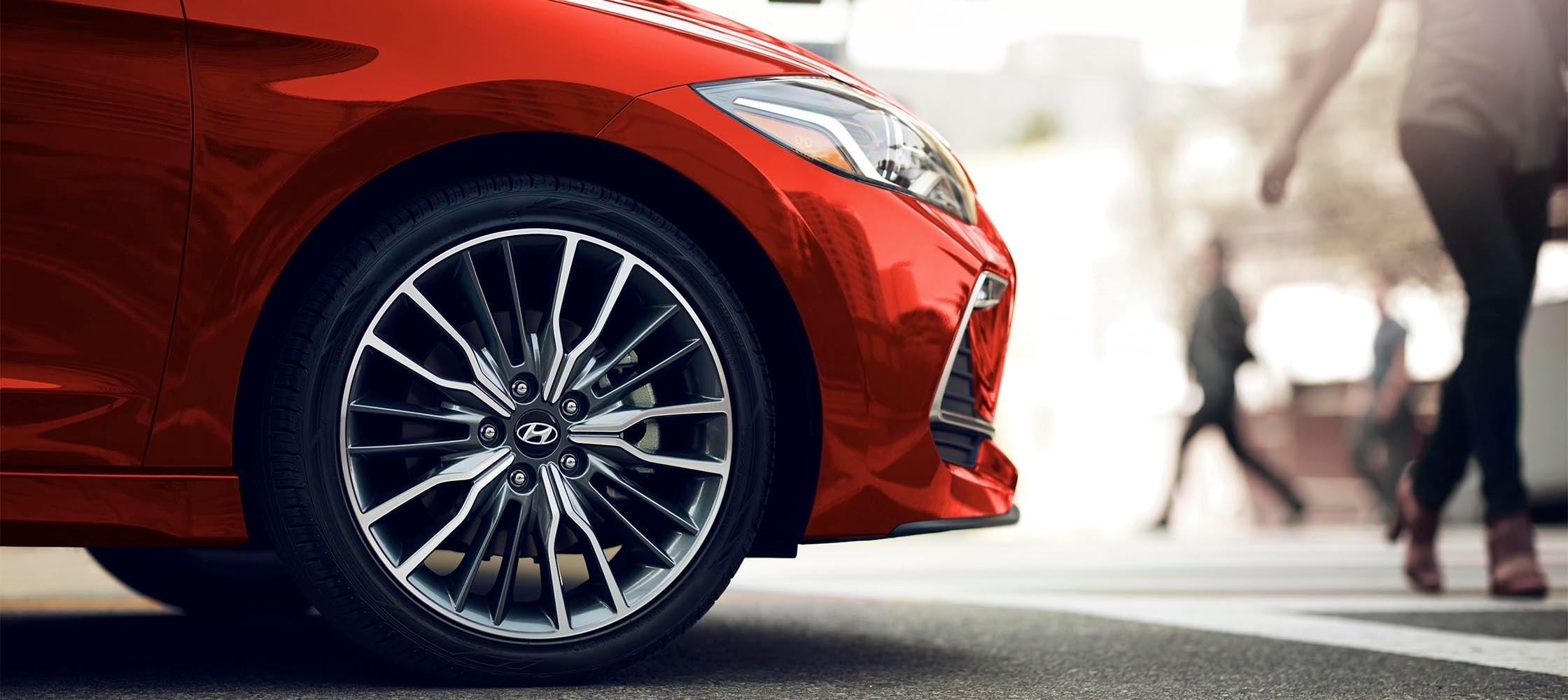 Side view of red Hyundai Elantra Sport 2017 muscular 18 inch alloy wheels