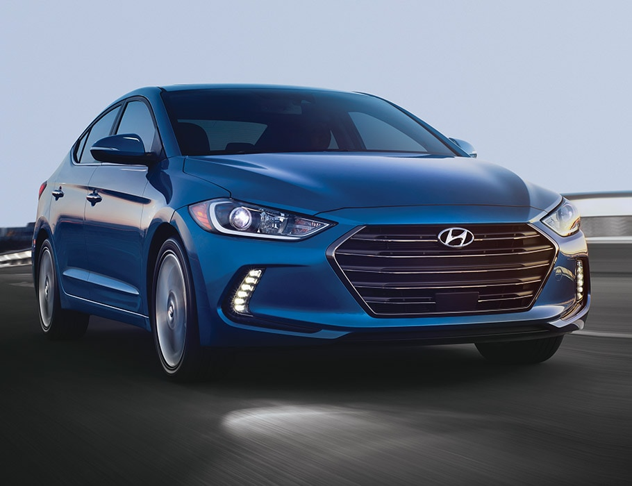 Exterior photo of blue Hyundai Elantra V3 2017 front grill, sleek headlights, and side door