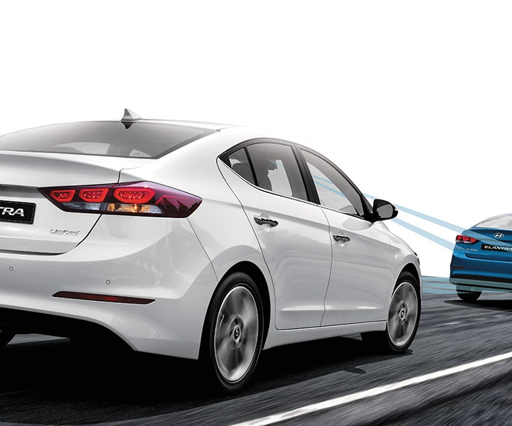 photo of white Hyundai Elantra V3 2017 closely following a blue car