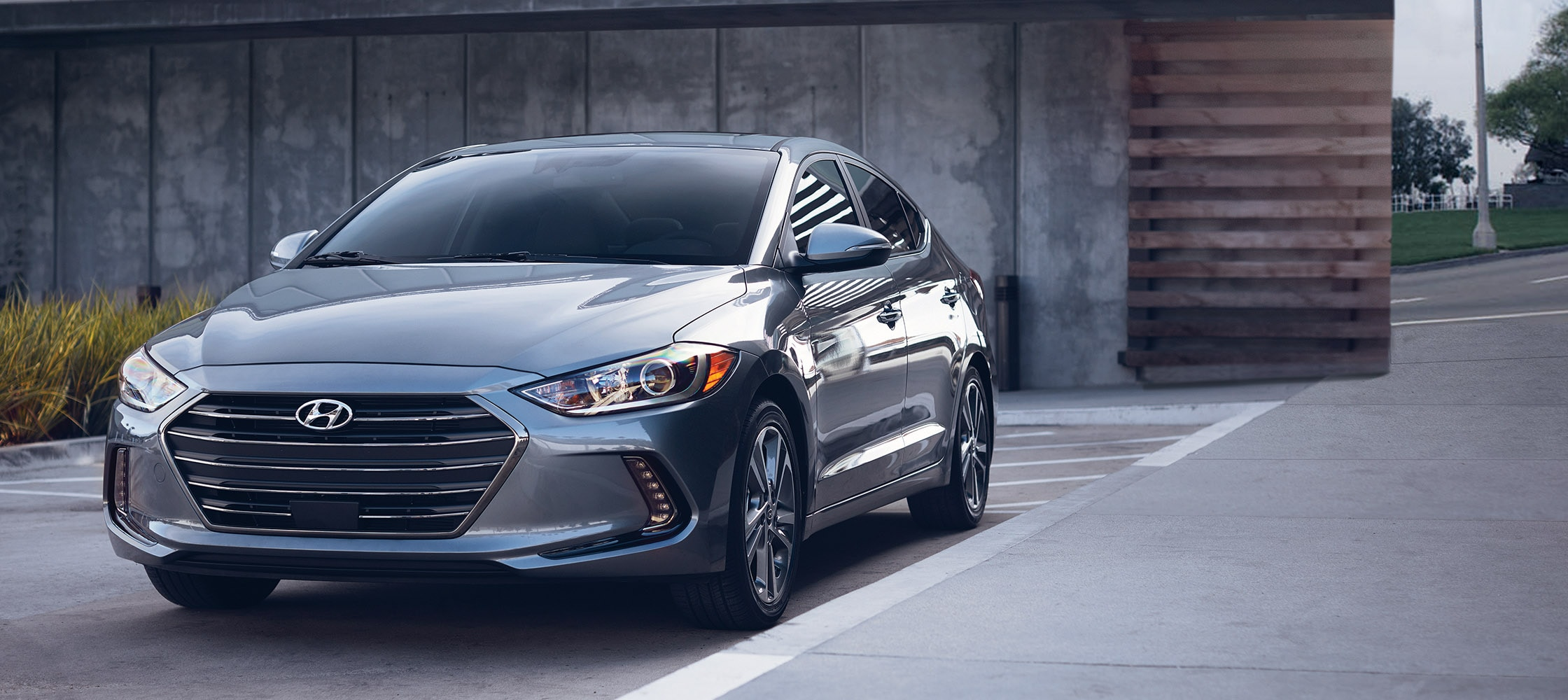 photo of grey Hyundai Elantra V3 2017 front grill, sleek headlights, and side door