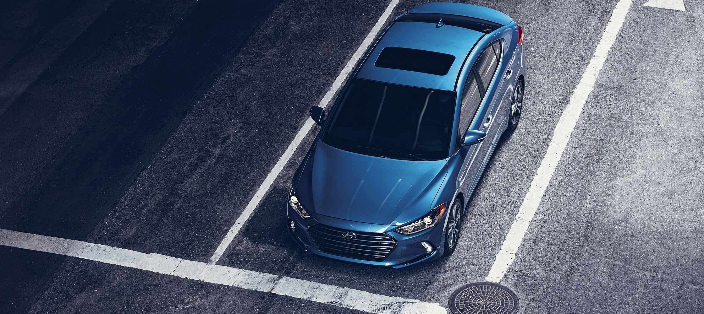 Birds eye view of blue Hyundai Elantra V3 2017 with power sunroof