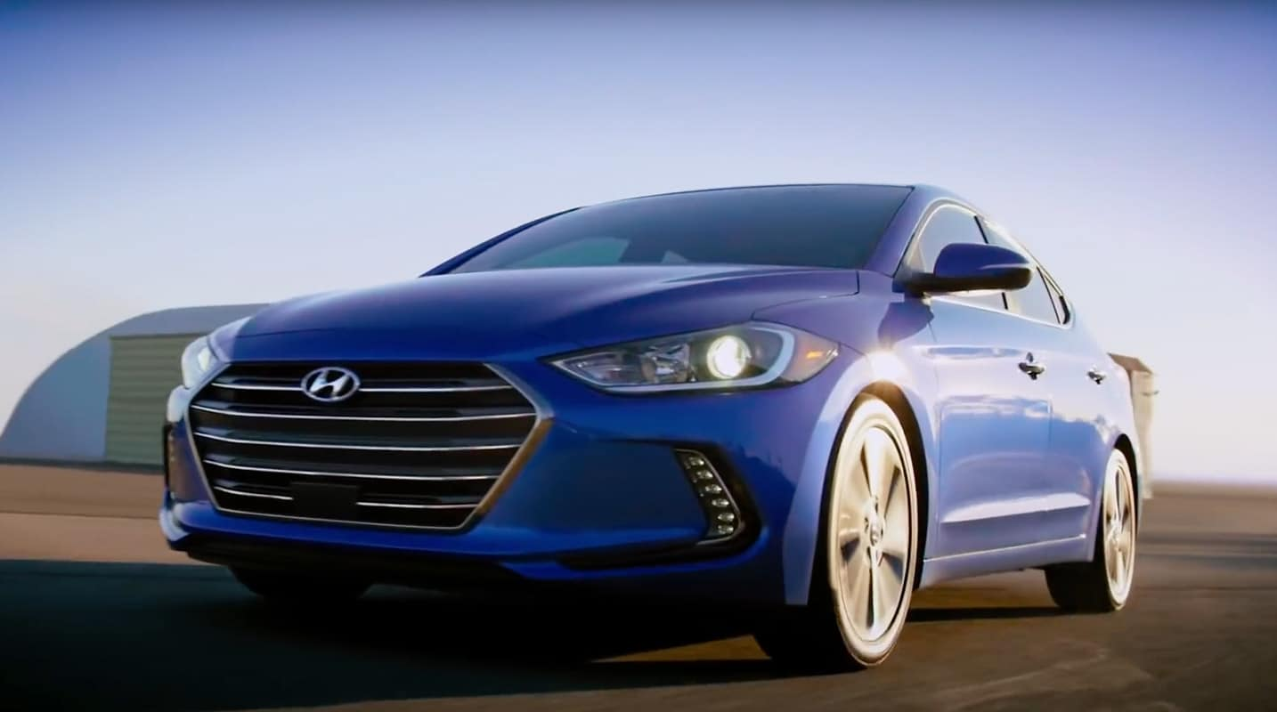 A sunny day on an air strip highlights the body design and styling on this Moon Light Blue 2017 Hyundai Elantra