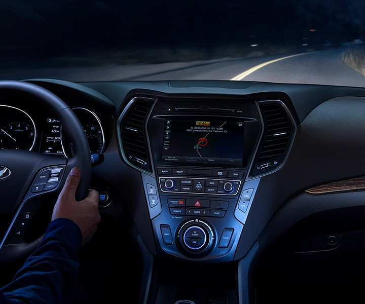 Image Of Interior Cabin And Dashboard Lights Glowing Blue On A 2017 Hyundai Santa Fe Sport SUV | Dark Road Taken From Rear Seats