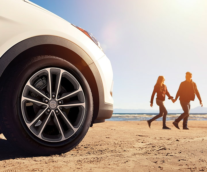 Close Up Of The Wheel Well And Alloy Wheels On The Hyundai Santa Fe SUV on a sunny beach | 2017