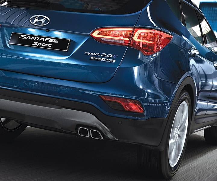A Dynamic Night Time Photo Of The Rear 1/4 Panel, LED Break-Lights And Passenger Side Of An SUV | Santa Fe 2017 | Hyundai