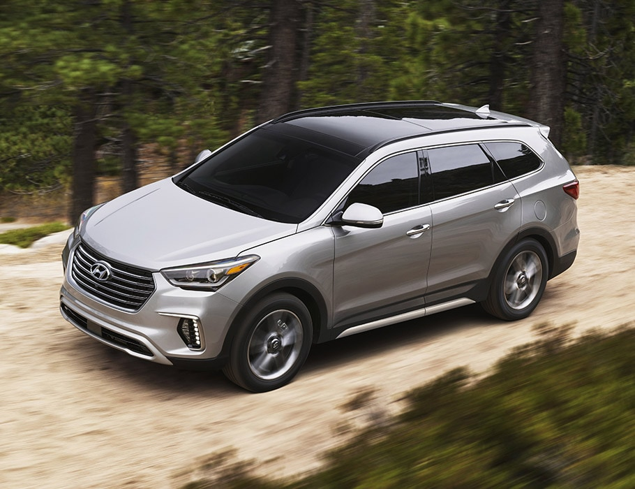 Exterior photo of grey Hyundai Santa Fe XL 2017 SUV with tinted windows and sun roof