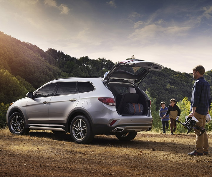Exterior photo of Hyundai Santa Fe XL SUV's trunk opening hands-free with smart power lift gate