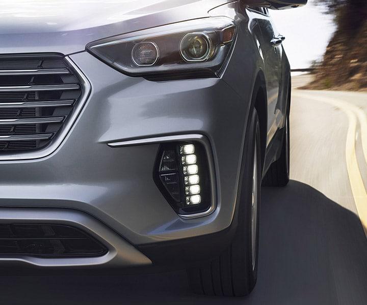 Exterior action photo of sporty Hyundai Santa Fe XL 2017 SUV using advanced lighting technology