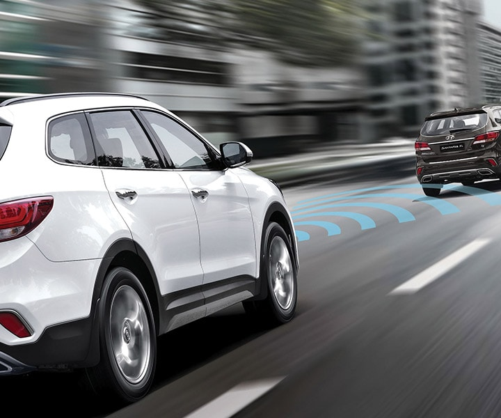 Exterior action photo of white Hyundai Santa Fe XL 2017 sporty and sophisticated SUV