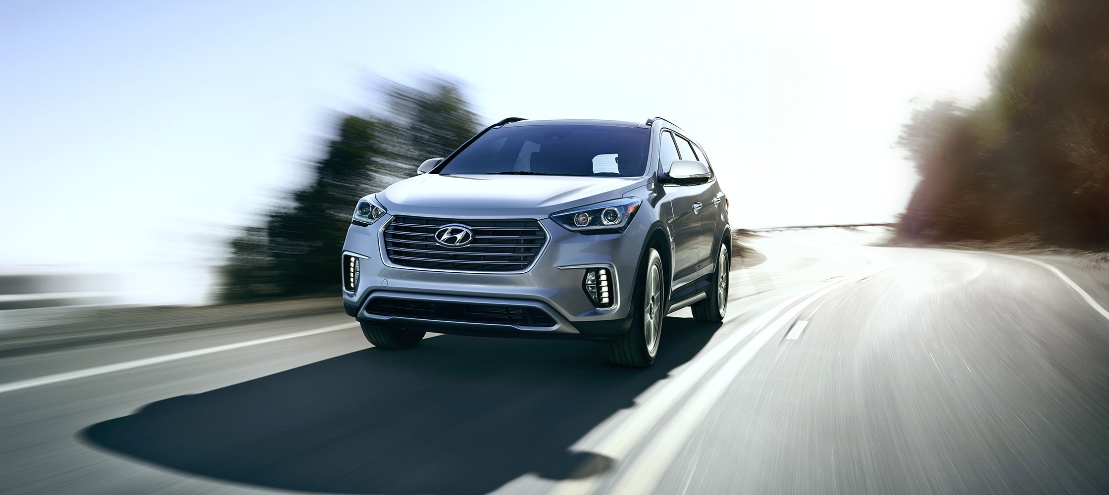 Exterior photo of silver Hyundai Santa Fe XL 2017 SUV sophisticated front grill and sporty presence
