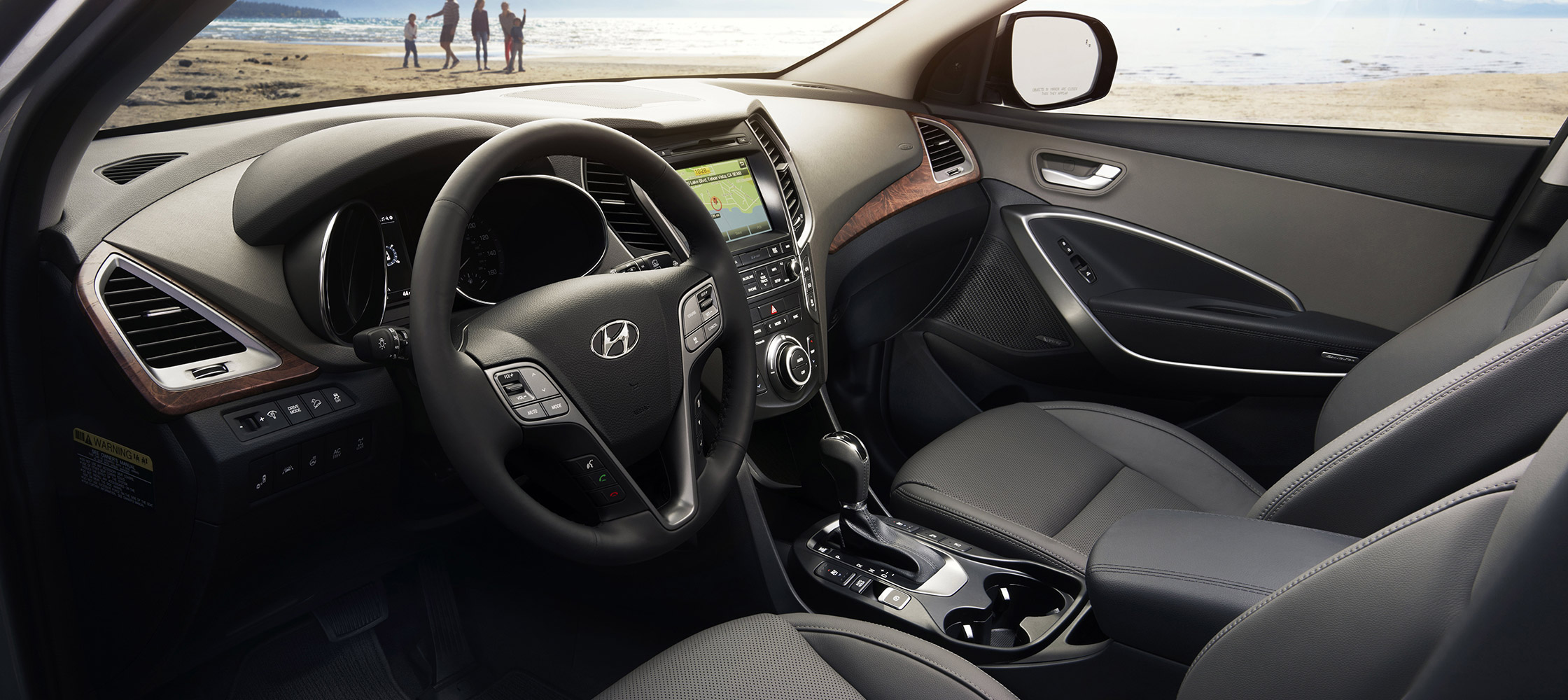 Interior photo of spacious Hyundai Santa Fe XL 2017 front leather seats and large windows