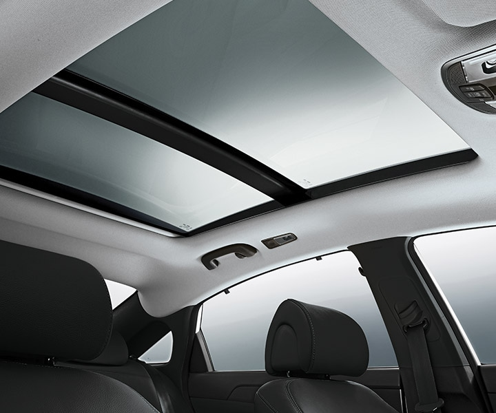 Interior image of Hyundai Sonata Hybrid 2017 sedan panoramic sunroof spanning over front and rear seats