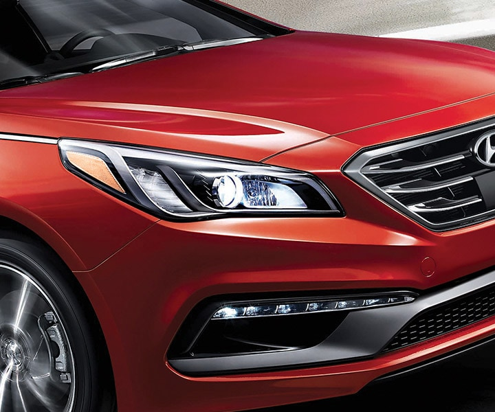 Exterior action photo of red Hyundai Sonata 2017 four door sedan using cruise control
