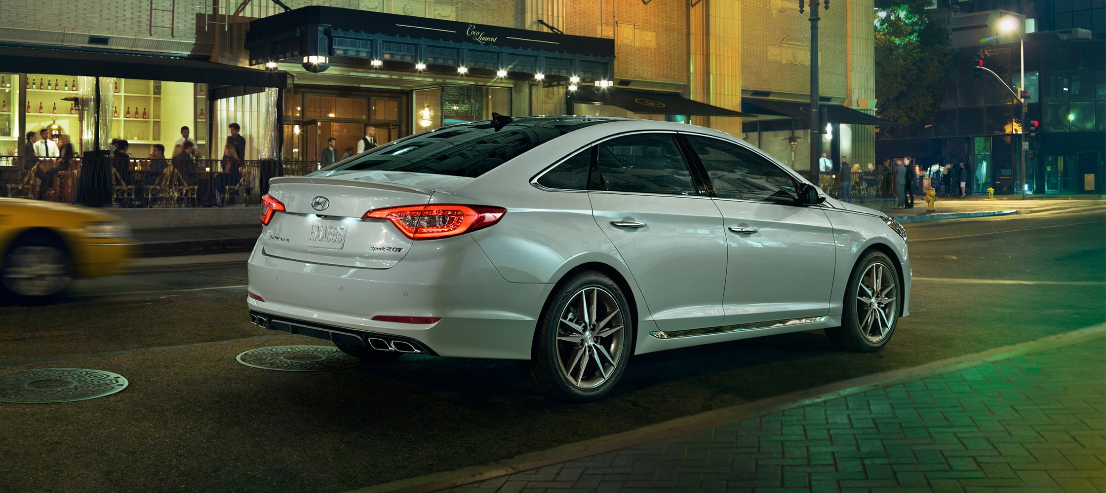 Exterior action photo of white Hyundai Sonata 2017 following another car at a safe distance
