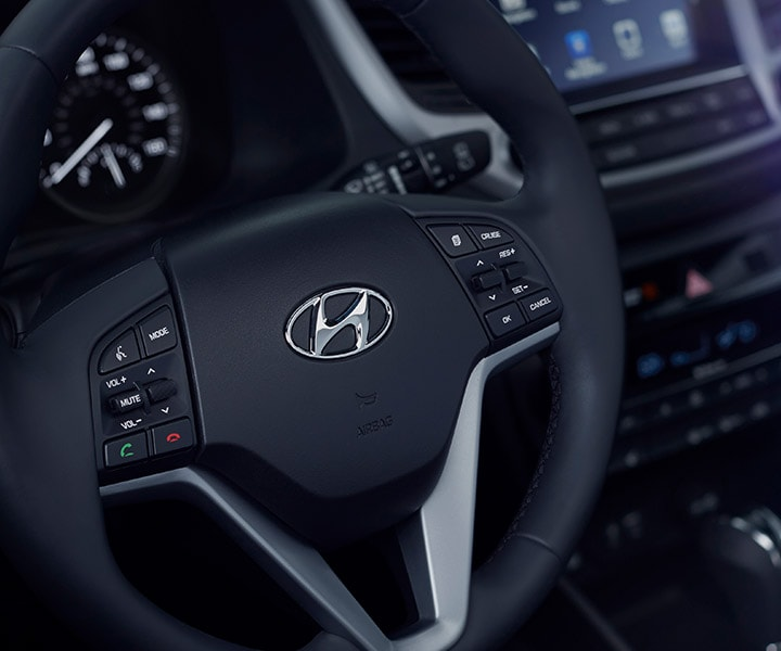 Image of Hyundai logo on Tucson 2017 CUV leather heated steering wheel with controls