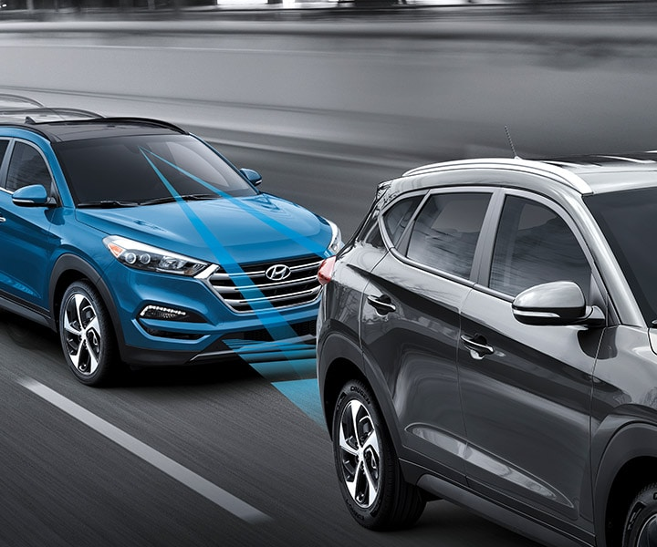 Exterior action photo of blue Hyundai Tucson 2017 CUV using autonomous emergency braking to prevent collision