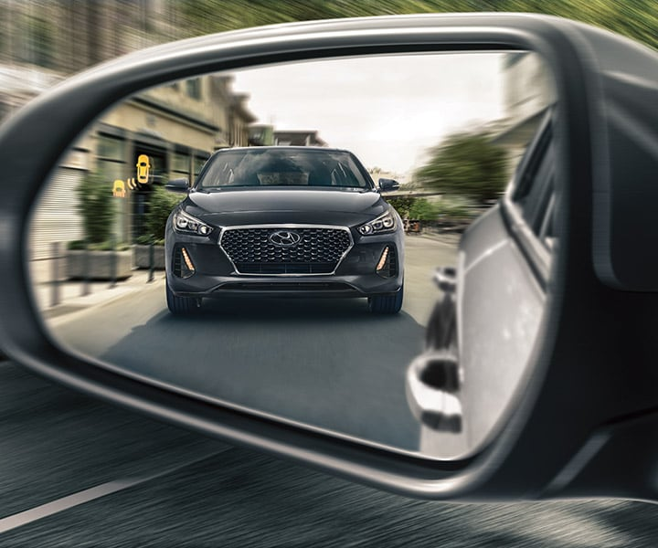 Shot of the 2018 Elantra GT's side mirror with Blind Spot Detection with Lane Change Assist