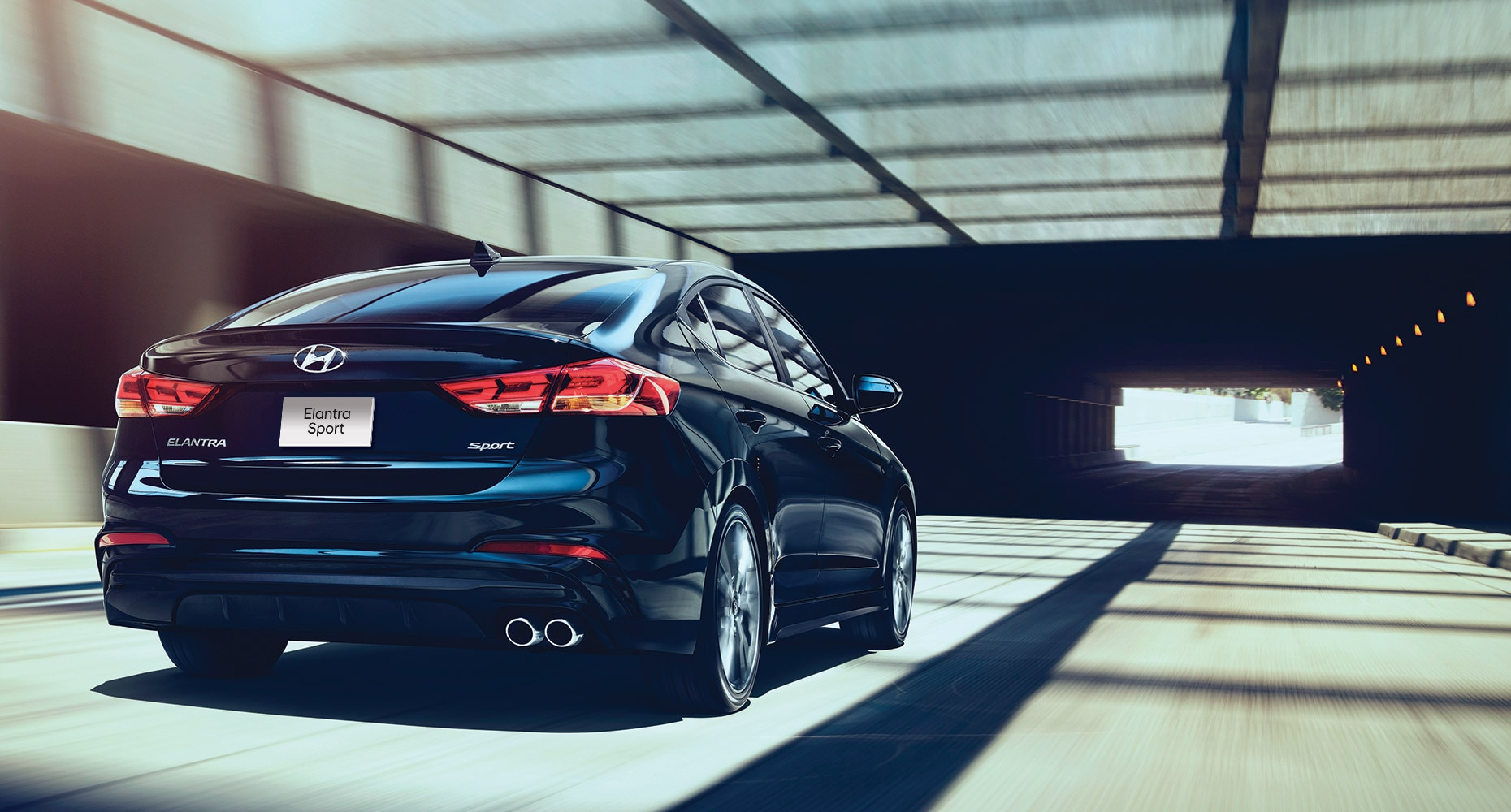 the hyundai 2018 elantra sport in blue going through a city tunnel. Black Bedroom Furniture Sets. Home Design Ideas
