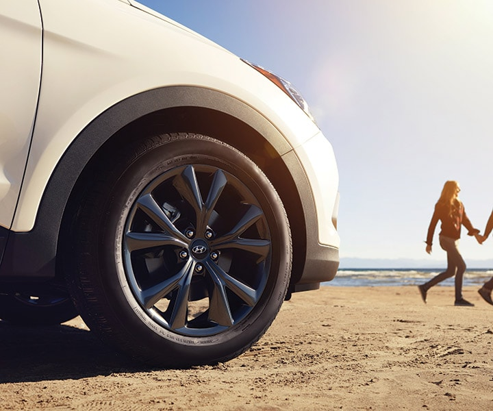 Close Up Of The Wheel Well And Alloy Wheels On The Hyundai 2018 Santa Fe SUV on a sunny beach