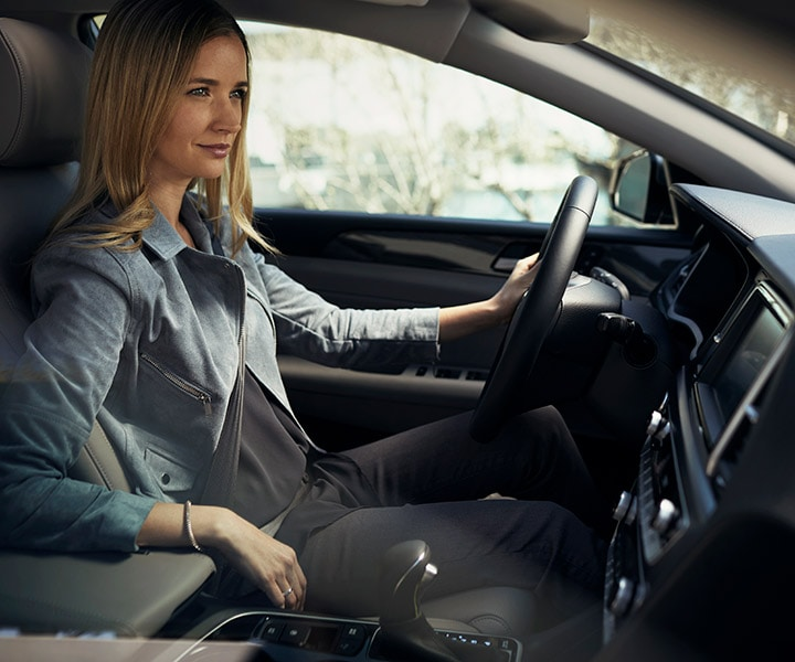 Close up of a woman driving in the 2018 Sonata by Hyundai.