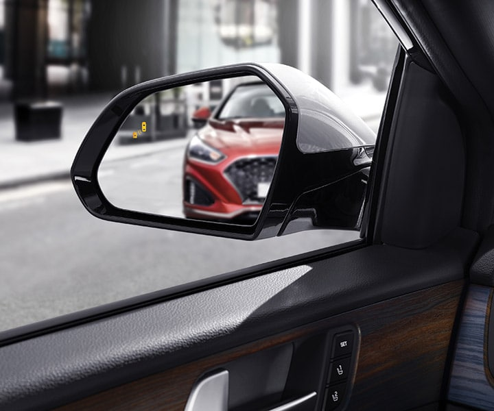 Image of car in the distance in rearview mirror of a 2018 Sonata by Hyundai.