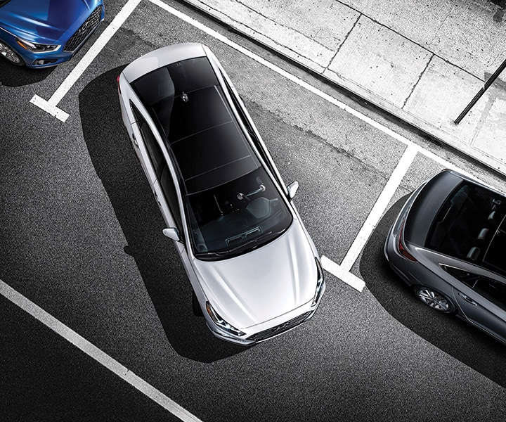 The rear parking assist system of a 2018 Sonata in action when parking in a tight spot.