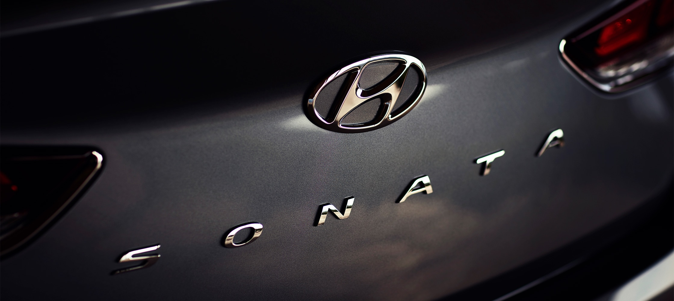 Closeup of the Hyundai 2018 Sonata logo on the car trunk.