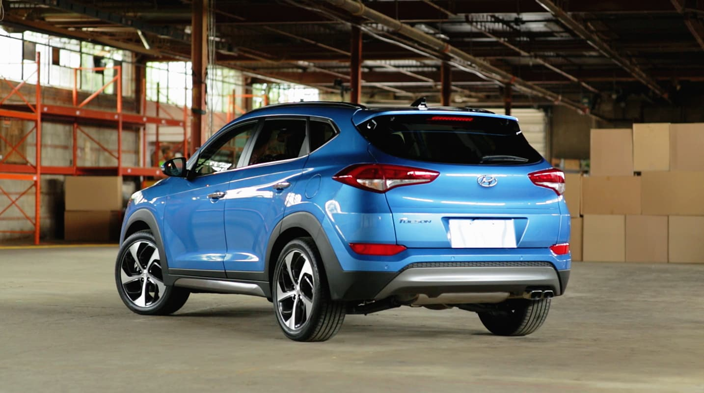 image of the 2017 tucson in blue in a garage by hyundai. Black Bedroom Furniture Sets. Home Design Ideas